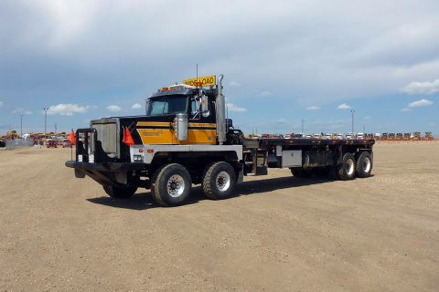 "2005 Western Star 6900XD 385"" Day Cab Twin Steer Sisu Rears Bed Truck"